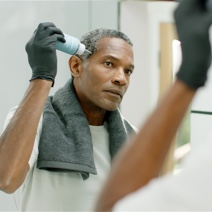 Man applying Colorsmith Custom Color to blend gray hair